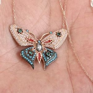 Turquoise Topaz &Emerald butterfly necklace